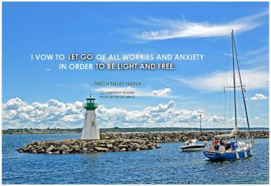 A photo of a lighthouse and sailboat that says I vow to let go of all worries and anxiety in order to be light and free acts as inspiration to stay clean and serene