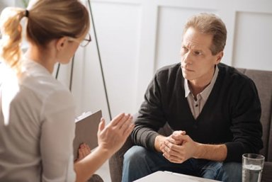 man participating in psychotherapy