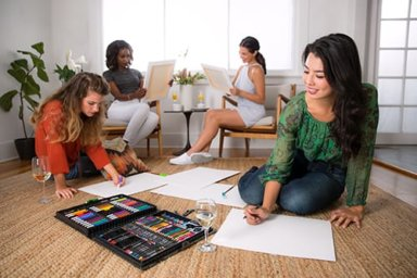 group of women participating in art therapy